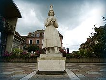 Statue of Marie Harel in white stone