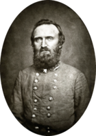 Middle aged man with large beard in military uniform