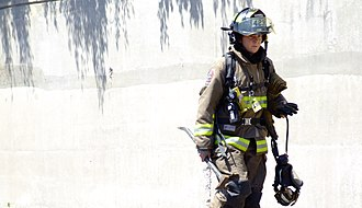 Toronto Fire Services - A firefighter from the Toronto Fire Services in firefighting gear.
