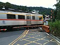 TRA DR1000 across level crossing on Pingshi Line 20100616.jpg