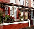 Terrace house with begonias in Moss Side, Manchester - panoramio.jpg