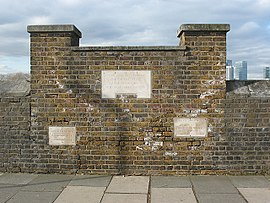 Thames flood level markers at Trinity Hospital Greenwich.jpg