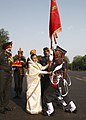 The President, Smt. Pratibha Devisingh Patil presenting the flag of the Chief of Army Staff to cadet, during the Passing Out Parade Spring Term 2011, Indian Military Academy, at Dehradun, Uttarakhand on June 11, 2011.jpg