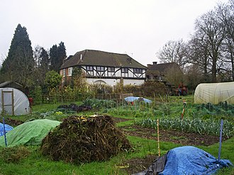 The surviving building of the former Dominican priory established in 1308 by Edward II, next to the Royal Palace of Kings Langley. The Priory and allotments, Kings Langley (geograph 2310899).jpg