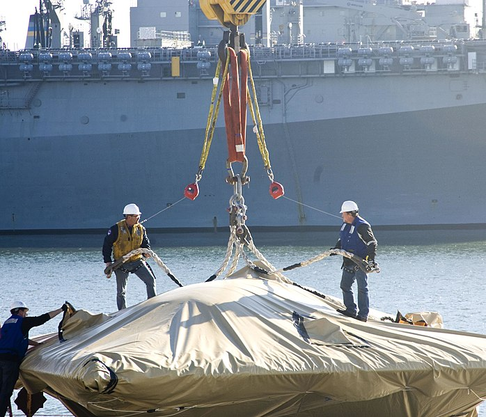 File:The X-47B Unmanned Combat Air System demonstrator is loaded onto USS Harry S. Truman. (8224464250).jpg