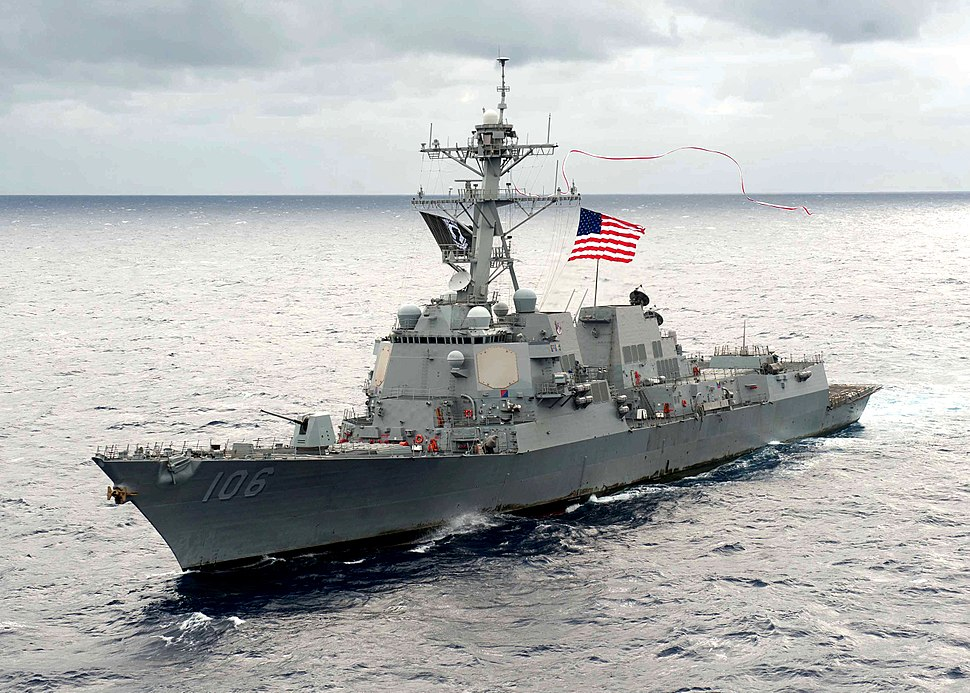 The guided-missile destroyer USS Stockdale (DDG 106) flies a 240-foot long homeward bound pennant from its mast as it steams through the Pacific Ocean on 131105-N-ZZ999-003