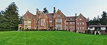Red brick mansion with a sprawling lawn