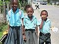 Three children in school uniforms, Punta Gorda, Belize, 2010.jpg