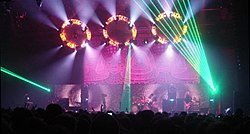 Tool performing live in 2006, showcasing an elaborate light show, using 10,000 Days artwork as backdrop.