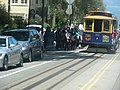 Tourists and cable car at Hyde and Lombard Street, SF.jpg