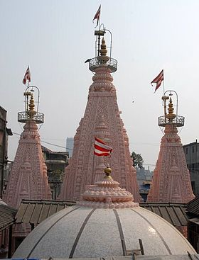 The Three Spires and dome of the Sabha Mandap atop the temple