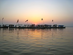 Triveni Sangam - Pilgrims at the Triveni Sangam, the confluence of the Ganges and the Yamuna rivers in Allahabad.