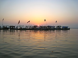 Triveni Sangam - Pilgrims at the Triveni Sangam, the confluence of the Ganges, Yamuna and a third mythical one, the Saraswati River, in Allahabad (Prayagraj).