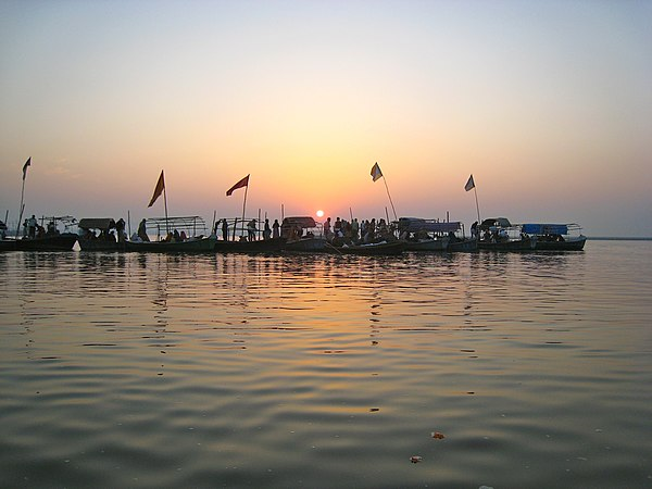 Pilgrims at the Triveni Sangam, the confluence of the Ganges and the Yamuna rivers in Allahabad. Triveni Sangam.JPG