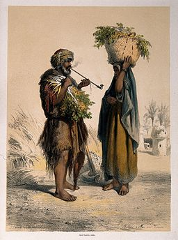 Two Egyptian peasants, the man smokes a pipe and the woman h Wellcome V0019291