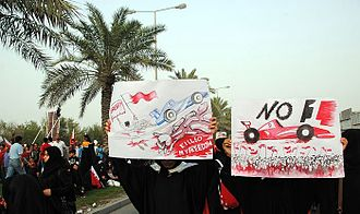 2012 Bahrain Grand Prix protests - Protesters holding anti-F1 signs during a protest on 20 April.