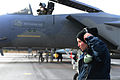 U.S. Air Force Airman 1st Class Ivy Collins, foreground, a crew chief with the 748th Aircraft Maintenance Squadron, puts on her headset before communicating with Lt. Col. Mike Casey, background, commander of 130116-F-BH151-178.jpg