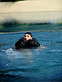 U.S. Air Force Tech. Sgt. Robert Martin, the noncommissioned officer in charge of survival, evasion, resistance and escape training for the 52nd Fighter Wing, treads water after disengaging his parachute harness 110729-F-MS171-022.jpg