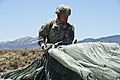 U.S. Army Col. Michael Fenzel, the commander of the 3rd Brigade Combat Team, 82nd Airborne Division, packs his parachute following an air-to-ground jump during a joint forcible entry exercise May 31, 2013 130531-F-UJ108-006.jpg