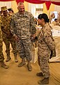 U.S. Army Maj. Gen. Robert Catalanotti, center, talks with a Sailor during his visit with Marines and Sailors assigned to the Marine Corps 26th Marine Expeditionary Unit who are training in support of Eagle 130429-M-HF949-002.jpg