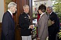 U.S. Marine Corps Gen. James F. Amos, center, the commandant of the Marine Corps, and retired Secretary of the Navy and former U.S. Sen. John Warner, left, the Evening Parade guest of honor, greet guests during 130503-M-LU710-021.jpg