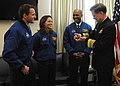 U.S. Navy Adm. Mark Ferguson, right, the vice chief of naval operations, receives an autographed 8-ball from three visiting astronauts from NASA's 2013 astronaut candidate class at the Pentagon, Arlington Va 140131-N-TK177-031.jpg