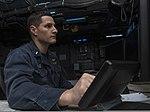 U.S. Navy Lt. j.g. Ian Neale stands watch in the joint operations center aboard the amphibious assault ship USS Boxer (LHD 4) in the Arabian Sea Jan. 1, 2014 140101-N-MK881-115.jpg