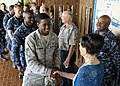 U.S. Sailors and Airmen assigned to Joint Base Pearl Harbor-Hickam, Hawaii, thank Carole and Jim Hickerson and Tim Guard after a prisoner of war event at the Joint Base Pearl Harbor-Hickam Memorial Chapel 130326-N-ZK021-008.jpg