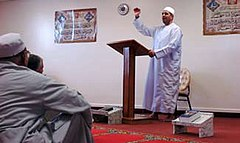 Muslim Air Force Chaplain (Captain) Walid Habash speaks to Muslim troops following a prayer service on Friday, December 19, 2009.