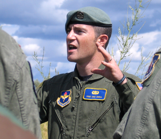 USAF SERE Instructor explaining how to jump safely with a parachute USAF SERE Beret.png