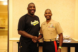 Doug Williams (quarterback) - Williams (left) as head coach of Grambling State, posing with a marine (right) in November 2011.