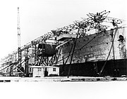 USS Langley (CV-1) being converted to an aircraft carrier at the Norfolk Naval Shipyard, 14 May 1921 (NNAM.1996.488.010.002)