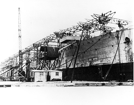 Langley being converted from a collier to an aircraft carrier at Norfolk Naval Shipyard in 1921. USS Langley (CV-1) being converted to an aircraft carrier at the Norfolk Naval Shipyard, 14 May 1921 (NNAM.1996.488.010.002).jpg