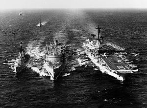 USS Sacramento (AOE-1) refuels USS Hancock (CV-19) and USS Robison (DDG-12) in the Western Pacific on 10 January 1965 (USN 1109945).jpg