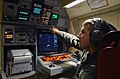 US Navy 030408-N-6501M-002 Lt. j.g. Dan J. Kitzmiller operates the navigation station aboard a P-3C Orion during a return flight from Edwin-Andrews Air Base located in Zamboanga City.jpg