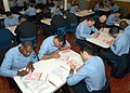 US Navy 040115-N-2972R-016 First Class Petty Officers assigned aboard USS Kearsarge (LHD 3) checks their answer sheets prior to beginning the Chief Petty Officer Exam.jpg