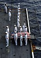 US Navy 040519-N-4533L-001 Crew members aboard USS Enterprise (CVN 65) conduct a Burial at Sea for Machinist's Mate 3rd Class Nathan Taylor.jpg