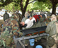 US Navy 040623-N-0000W-168 Members of the U.S. Naval Hospital, Yokosuka's secondary decontamination team helps ensure a simulated casualty is chemical free before continuing treatment at the hospital.jpg