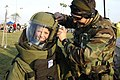 US Navy 040803-N-2537P-008 A young boy is fitted into an Explosive Ordnance Disposal suit by a member of Explosive Ordnance Disposal Mobile Unit Eight (EODMU 8).jpg