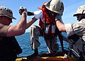 US Navy 050430-N-5526M-031 Sailors aid men and women after their boat, a fishing vessel, capsized 25 miles off the coast of Somalia.jpg