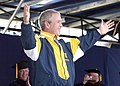 US Navy 050527-N-5390M-206 U.S. President George W. Bush tries on a Naval Academy windbreaker presented to him by a graduating Midshipman during the 2005 Naval Academy Graduation Ceremony.jpg