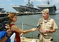 US Navy 050831-N-3725R-007 Commander, Second Fleet, Vice Adm. Mark Fitzgerald talks with WTKR Channel 3 reporter Stacy Davis during a press conference.jpg