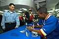 US Navy 050910-N-8604L-202 Sailors assigned to USS Kitty Hawk (CV 63) take advantage of an autograph session with the Harlem Globetrotters basketball team aboard Kitty Hawk's mess decks.jpg
