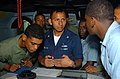 US Navy 060421-N-5307M-769 Ship's Serviceman 3rd Class Richard Molina explains to members of the Dominican Republic's Navy and Marine Corps how to navigate the ship on the bridge aboard the guided missile destroyer.jpg