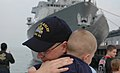US Navy 060608-N-4014G-069 Electronics Technician 1st Class Dave Jackel hugs his son, prior to boarding the guided-missile destroyer USS Bulkeley (DDG 84) at Naval Station Norfolk, Va.jpg