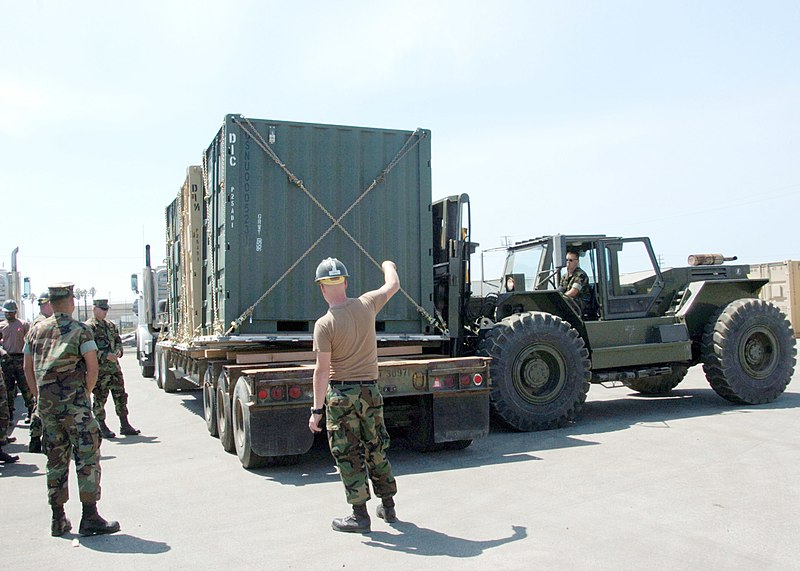 File:US Navy 060831-N-3560G-040 Members of Naval Mobile Construction Battalion Four (NMCB-4) prepare to transport Tricon Containers.jpg