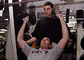US Navy 070227-N-0998G-003 Operations Specialist 3rd Class Greg Ivy, a native of Sacramento, Calif., incline presses two 30-pound dumbbells as Quartermaster Seaman Julian Marulanda, a native of Bridgeport, Conn., acts as spotte.jpg