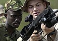 US Navy 070304-N-8154G-078 Cpl. Dustin Crouthamel, attached to Battalion Landing Team (BLT) 2-2 Fox Company, 26th Marine Expeditionary Unit (MEU), familiarizes a member of the Kenyan Army with his rifle.jpg