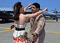 US Navy 070522-N-1082Z-002 Lt.Cmdr. Brian Cimicata assigned to the Pukin' Dogs of Strike Fighter Squardon (VFA) 143, greets his wife after arriving home.jpg