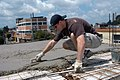 US Navy 070727-N-7029R-194 Lt. j.g. Matthew Dalton, attached to Destroyer Squadron (DESRON) 40, smoothes cement while creating a roof at the Calvary Chapel in Guatemala City during a community relations project in support of P.jpg